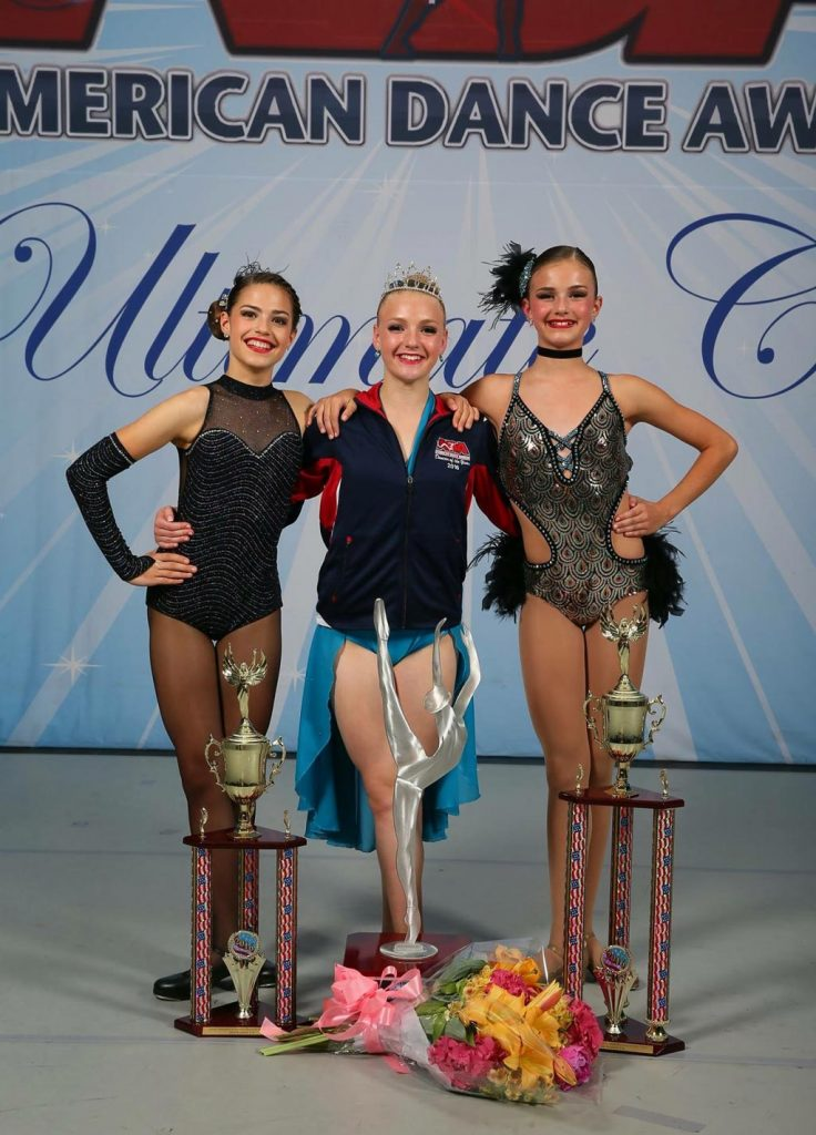 The winning dancers pose with their trophies at the American Dance Awards